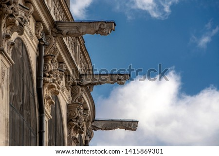 Stone sculptures on facade of the Saint Eustache church (glise Saint-Eustache), Les Halles against the blue cloudy sky. Gothic facade, Paris, France Photo stock ©