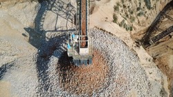 Stone sorting conveyor belt in a large Quarry - Top down aerial view