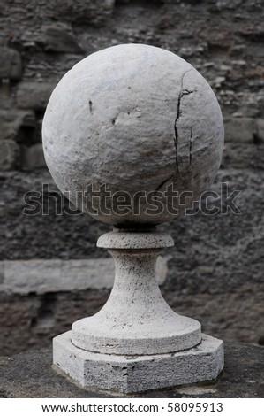stone sphere on pedestal