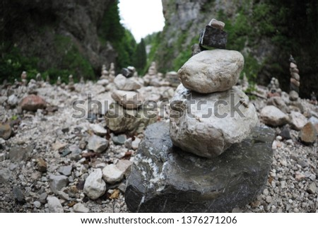 Stone stacking in river canyon where hike path leads to the Gozd Martuljek's waterfalls. People stacked the stones for relaxation and fun. After the heavy rain the sculptures were gone. #1376271206