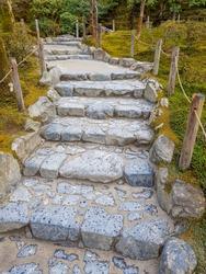 Stone stair in zen garden. Shot in the winter of Ginkakuji Temple Kyoto / Japan.Silver Pavilion famous moss garden.