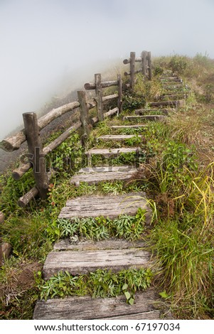 Stone stair with fence beside and surrounded by fog
