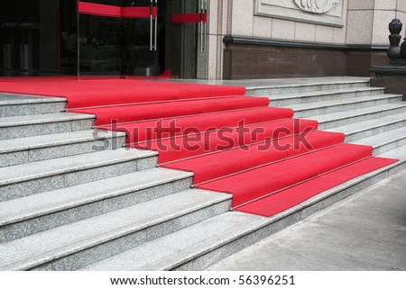 Stone staircase covered with red carpet
