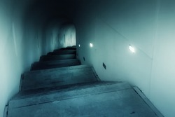 Stone staircase in a dark tunnel