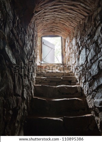 stone stairs going from a cellar - stock photo