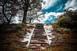 stone stairs with yellow metal rings