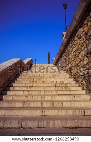 Stone stairways at the center of the city during a sunny day. #1266258490