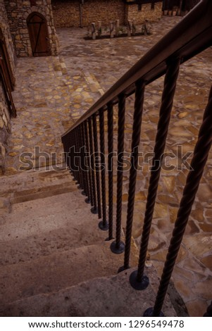 Stone stairways from tower to the garden. #1296549478