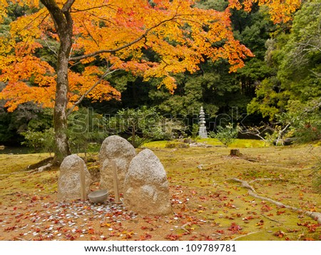 Stone statuary and a rock pagoda in Kinkakuji temple (The golden pavilion temple) in Kyoto, Japan
