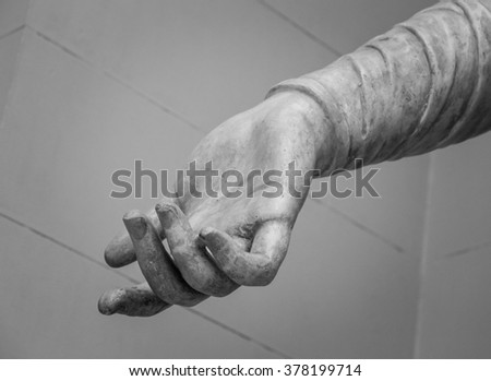 stone statue detail of human hand  #378199714