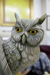 Stone statue of an owl used to decorate rooms and desks