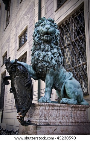 Stone statue of lion - ancient decoration in Munich residence, Germany