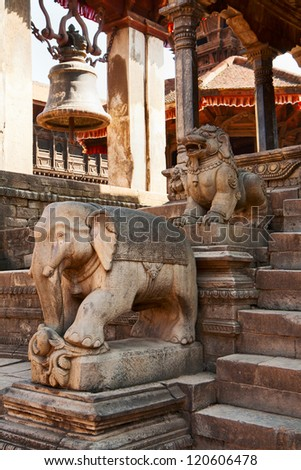 Stone statues at the entrance to the Hindu temple, Bhaktapur, Nepal