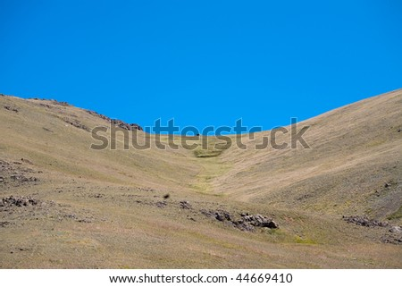 stone steppe and the blue cloudless sky
