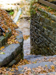 stone steps in autumn near the waterfall