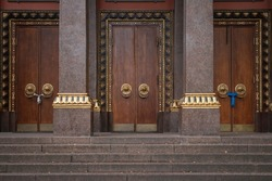 Stone steps to the wooden doors of a Buddhist temple in St. Petersburg, Russia.