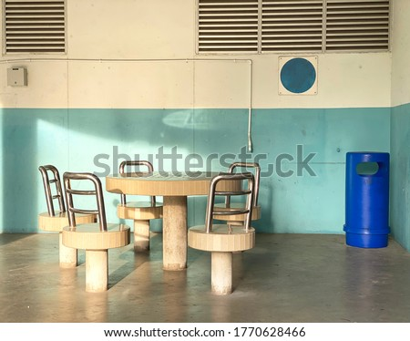 Stone stools and tables at void deck for residents to mingle Stockfoto ©