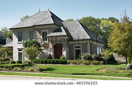 Stone & Stucco House with Slate Roof