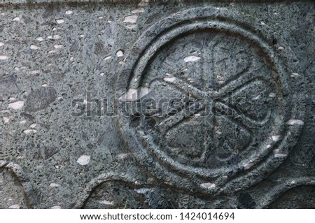 stone surface, stone texture. Vintage style, ancient symbol.