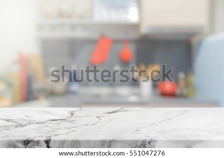 Stone table top and blurred kitchen interior background - can used for display or montage your products.