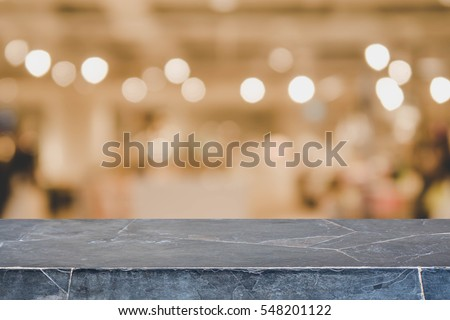 Stone table top and blurred restaurant interior background with vintage filter - can used for display or montage your products. #548201122