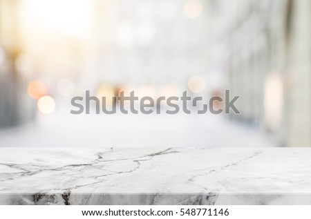 Stone table top and blurred shopping plaza background - can used for display or montage your products.