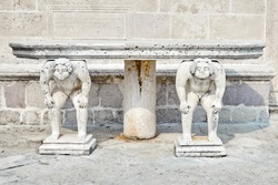 Stone table, which stands on two carved titans, Church of Our Lady of the Rocks, Perast, Montenegro