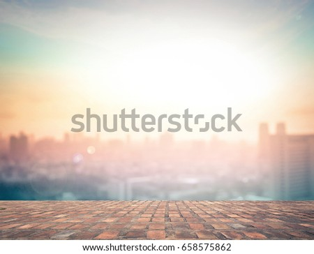 Stone terrace and blurred business city skyline sunrise background.