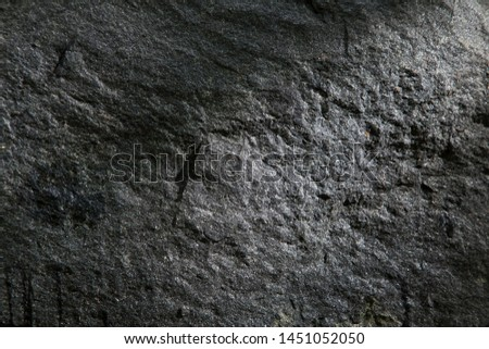 Stone textured background in a low key stock photo