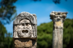 Stone theater mask from the decoration of the amphitheater in Ostia Antica, Roman colony founded in the 7th century BC. Rome, UNESCO world heritage site, Italy, Europe