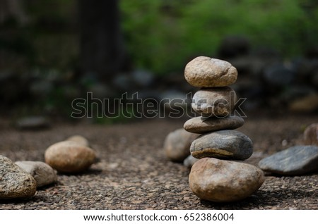 Stone tower and blurred bush background