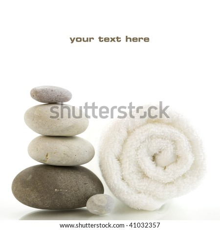 Stone tower and white towel with reflection on white background. With sample text