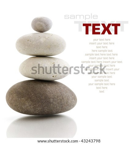 Stone tower with reflection on white background (with sample text)