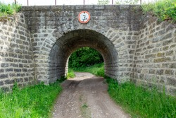 Stone tunnel for transport, under the railway