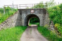 Stone tunnel under the railway