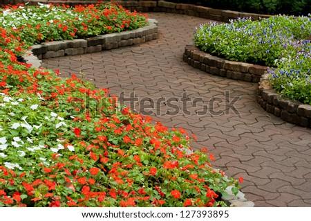 stone walkway in flower garden
