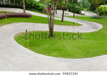 Stone walkway in the park with green grass