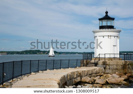 "Stone walkway leads up to Portland Breakwater lighthouse,  also to referred to as ""bug"" light, as the beacon guides boats in the harbor. Its architecture has grecian influence."