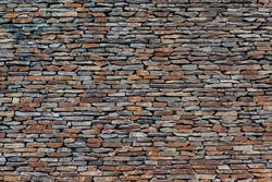 Stone wall background. Old dry stone texture pattern. Dry stacked wall assembled without mortar or cement