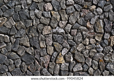 stone wall background with dark gray irregular slabs