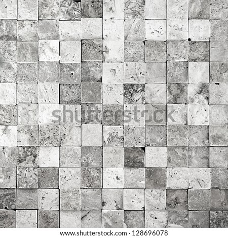 Stone wall from small pieces in gray color