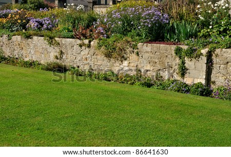 Stone Wall In Traditional English Garden Stock Photo 86641630 ...