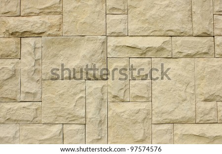 Stone wall made of various sizes stone, can be used as background. - stock photo