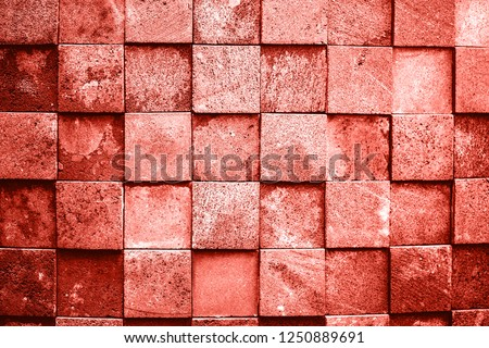 Stone wall made with squares. Living Coral Color of the year 2019. Main trend concept. #1250889691