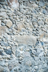 Stone wall of an antique house,  rustic texture big background
