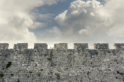 Stone wall of the castle and the contrasting sky.