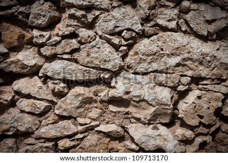 Stone wall texture background with dark edges