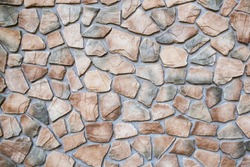 Stone wall texture. Mosaic rocks decorative interior wall background. Indoor modern apartment inspiration design.