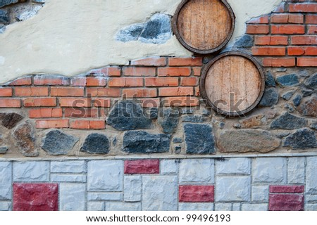 stone wall with a different texture to the barrels