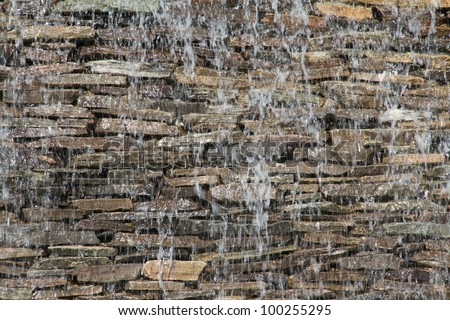 stone wall with a waterfall